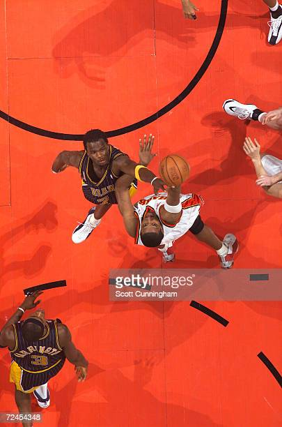 Forward Shareef AbdurRahim of the Atlanta Hawks shoots over forward Jermaine O''Neal of the Indiana Pacers during the NBA game at Philips Arena in...