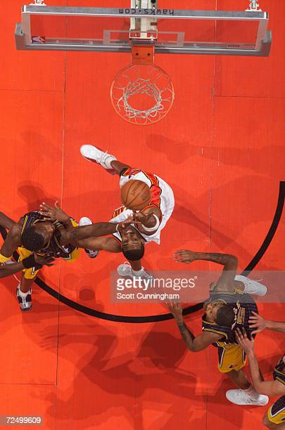 Forward Shareef AbdurRahim of the Atlanta rebounds over forward Jermaine O''Neal of the Indiana Pacers during the NBA game at Philips Arena in...