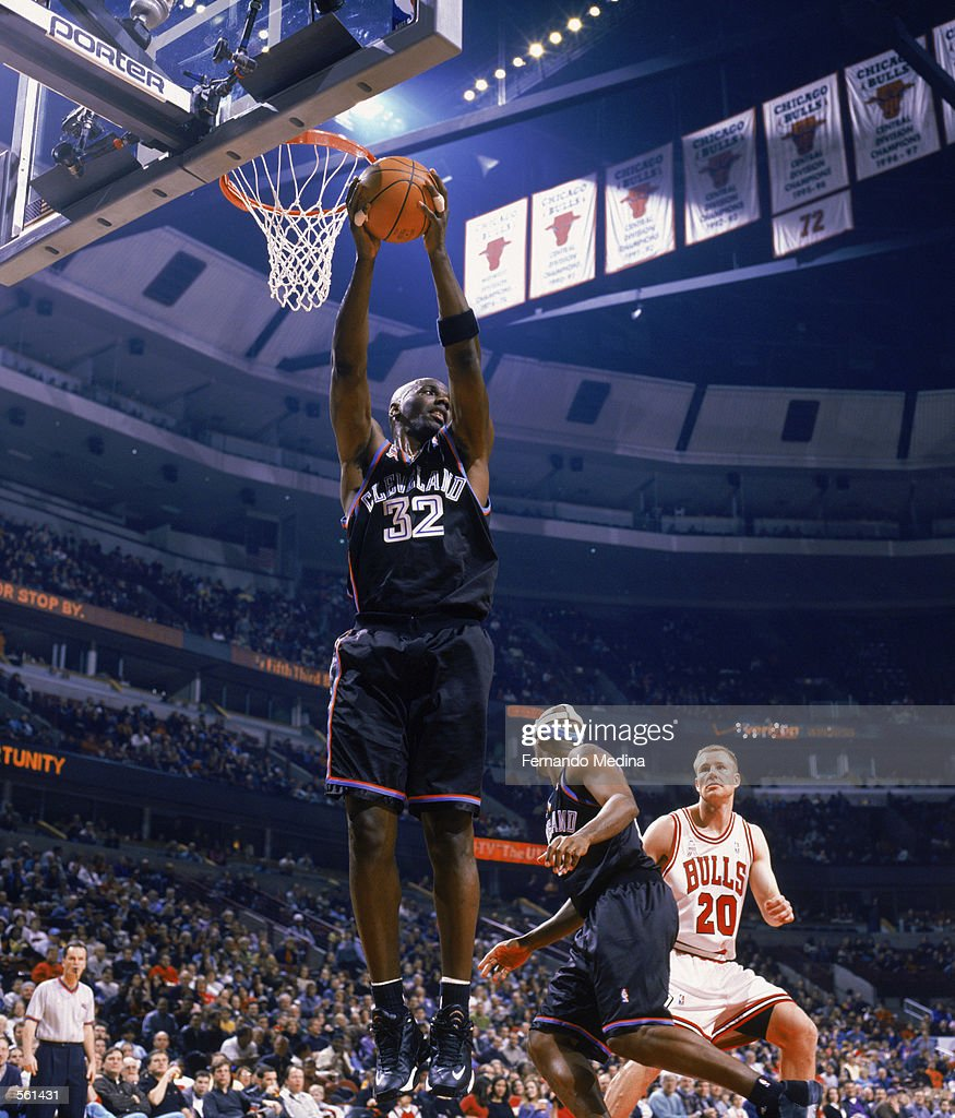 Tyrone Hill of the Cleveland Cavaliers rebounds
