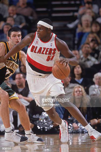 Forward Zach Randolph of the Portland Trail Blazers dribbles the ball around forward Vladimir Radmanovic of the Seattle SuperSonics during the NBA...