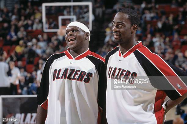 Forward Zach Randolph of the Portland Trail Blazers laughs with forward Ruben BoumtjeBoumtje during the NBA game against the Minnesota Timberwolves...