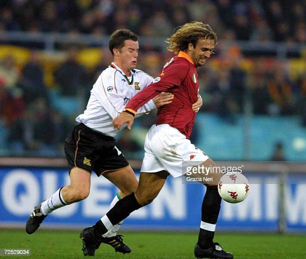Gabriel Batistuta of Roma is challenged by Daniel Andersson of Venezia during the Serie A match between Roma and Venezia played at the Olympic...