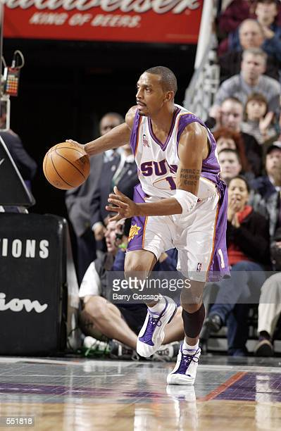 Guard Anfernee Hardaway of the Phoenix Suns dribbles the ball during the NBA game against the Boston Celtics at America West Arena in Phoenix Arizona...