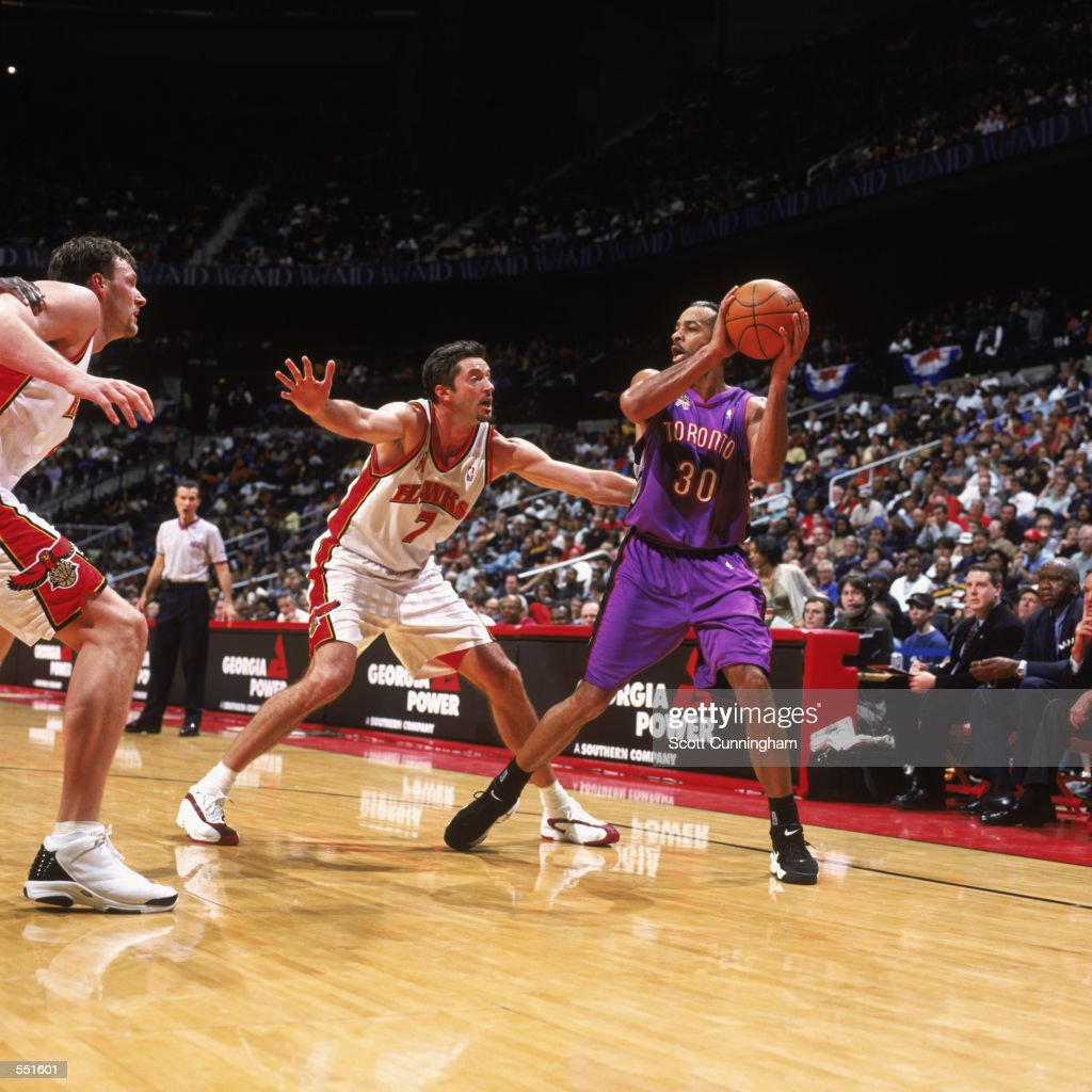 Dell Curry 30 of the Toronto Raptors holds the ball