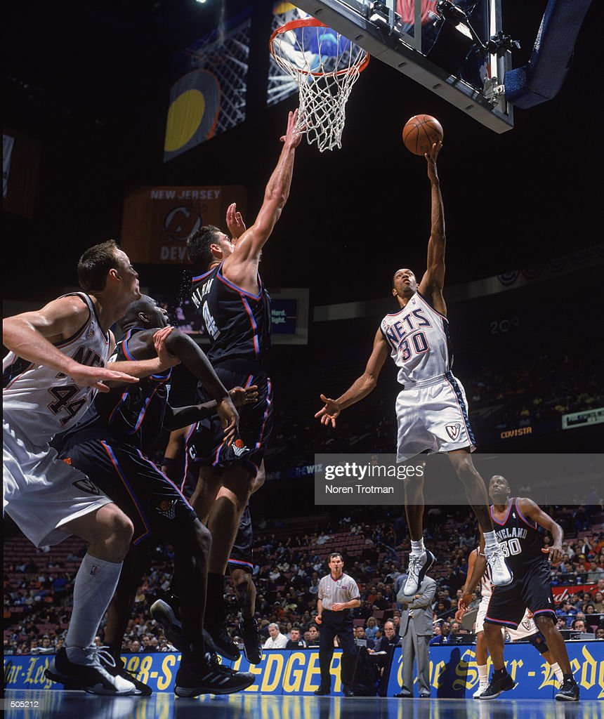 Kerry Kittles 30 of the New Jersey Nets attempts to shoot