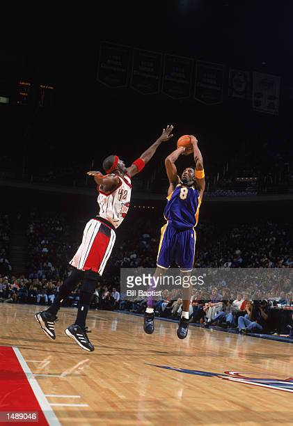Guard Kobe Bryant of the Los Angeles Lakers shoots over guard Walt Williams of the Houston Rockets during the NBA game at the Compaq Center in...