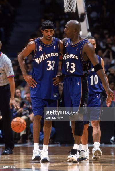 Guard Richard Hamilton of the Washington Wizards listens to guard Michael Jordan during the NBA game against the Memphis Grizzlies at the Pyramid...
