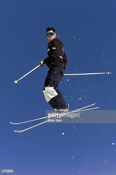 Jeremy Bloom twists off the first jump en route to a third place finish in the final round of mens'' moguls at the Sprint US Freestyle Grand National...