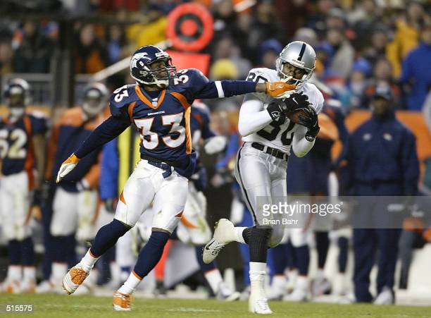 Jerry Rice of the Oakland Raiders pulls in a 70yard pass in front of cornerback Jimmy Spencer of the Denver Broncos in the fourth quarter at Mile...