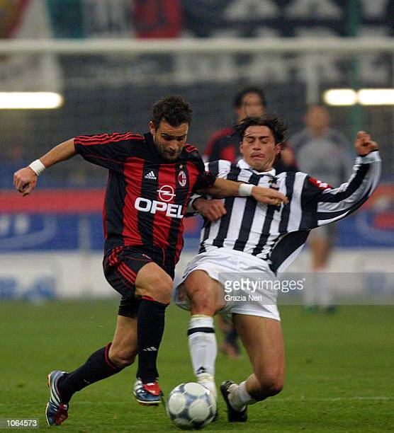 Marco Simone of Milan and Tacchinardi Alessio of Juventus in action during the Serie A 14th Round League match between AC Milan and Juventus played...
