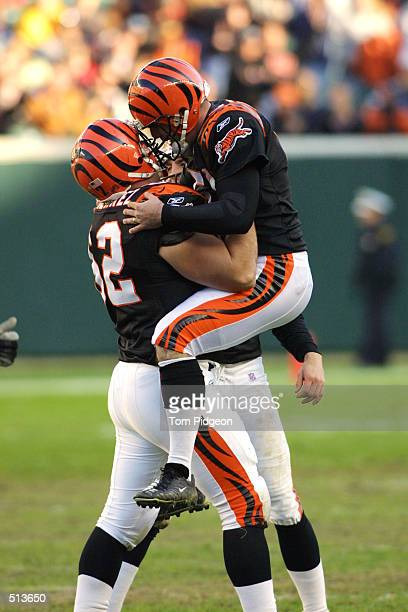 Neil Rackers of the Cincinnati Bengals celebrates a 47yard field goal against the Jacksonville Jaguars with teammate Brock Gutierrez during the game...