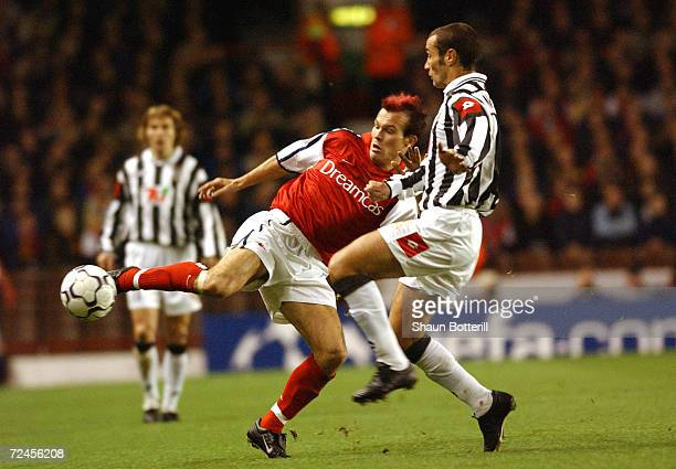 Paulo Montero of Juventus tackles Fredrik Ljungberg of Arsenal during the UEFA Champions League match between Arsenal and Juventus at Highbury London...