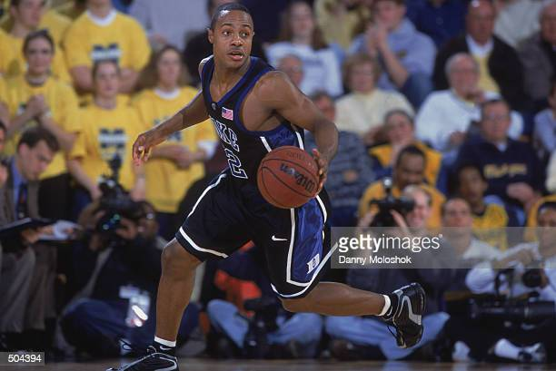 Point guard Jason Williams of the Duke Blue Devils dribbles the ball during the NCAA basketball game against the Michigan Wolverines at Crisler Arena...