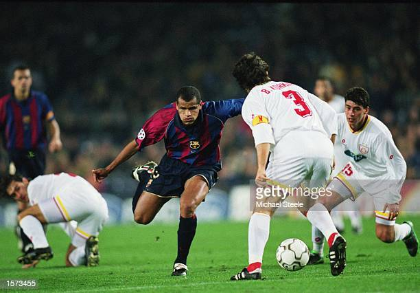Rivaldo of Barcelona takes on Bulent Korkmaz and Capone of Galatasaray during the UEFA Champions League Second Phase Group B match between Barcelona...