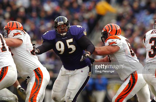 Sam Adams of the Baltimore Ravens figts off the defense of the Cincinnati Bengals during the game at PSINet Stadium in Baltimore Maryland The Ravens...