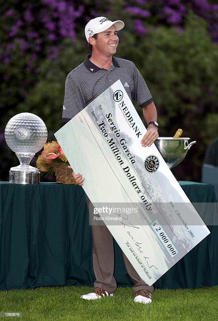 Sergio Garcia of Spain with the winners trophy and cheque after beating Erine Els at the first play off hole during Nedbank Golf Challenge at the...