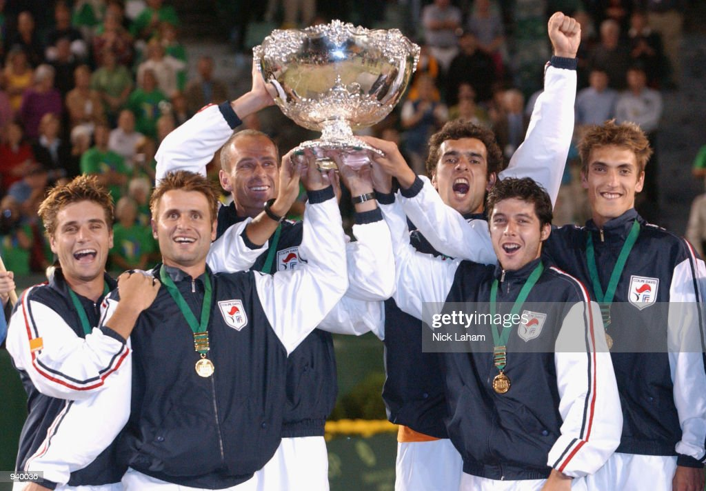 The victorious French team (l-r) Arnaud Clement, Fabrice Santoro, captain Guy Forget, Cedric Pioline, Sebastien Grosjean and Nicolas Escude celebrate winning the Davis Cup World Group Final Draw against Australia with the cup held at Rod Laver Arena in Melbourne, Australia. France defeated Australia 3-2. DIGITAL IMAGE Mandatory Credit: Nick Laham/ALLSPORT