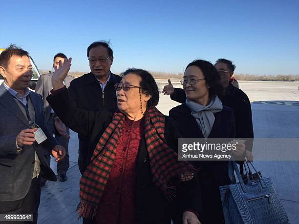 BEIJING Dec 4 2015 Chinese herbal expert Tu Youyou front leaves for Sweden to accept the Nobel Prize in Physiology or Medicine at the Beijing Capital...