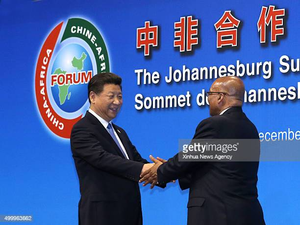 JOHANNESBURG Dec 4 2015 Chinese President Xi Jinping left shakes hands with South African President Jacob Zuma during the opening ceremony of the...