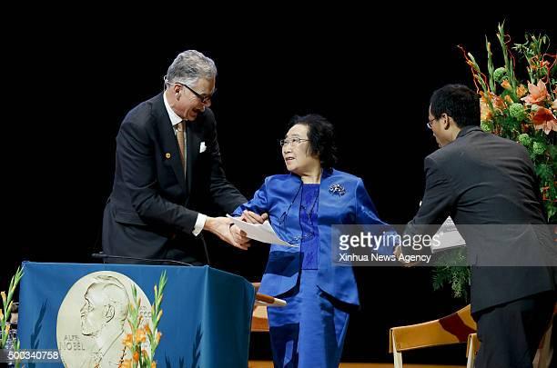 STOCKHOLM Dec 7 2015 China's Tu Youyou center who won 2015 Nobel Prize in Physiology or Medicine gives a lecture in Karolinska Institutet Stockholm...