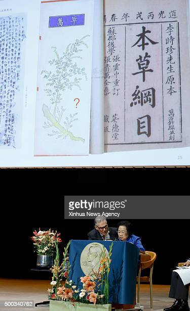 STOCKHOLM Dec 7 2015 China's Tu Youyou right who won 2015 Nobel Prize in Physiology or Medicine gives a lecture in Karolinska Institutet Stockholm...