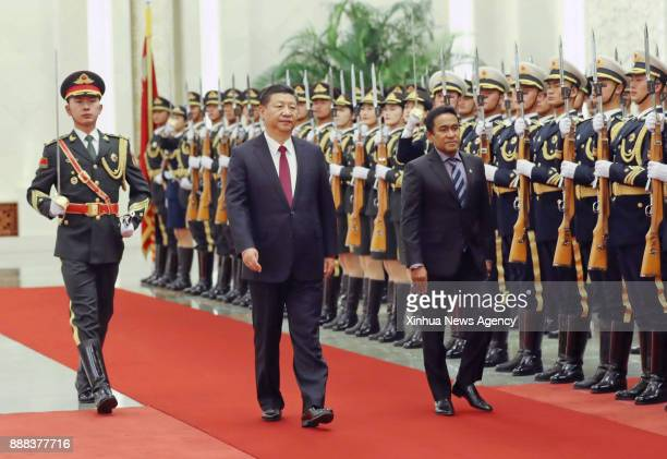 Chinese President Xi Jinping holds a welcome ceremony for visiting Maldives President Abdulla Yameen Abdul Gayoom before their talks at the Great...