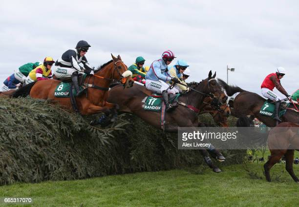 Decade Player ridden by DPeters and Mr Moss ridden by JNailor clear The Chair during the Randox Health Foxhunters' Open Hunters' Steeple Chase at...