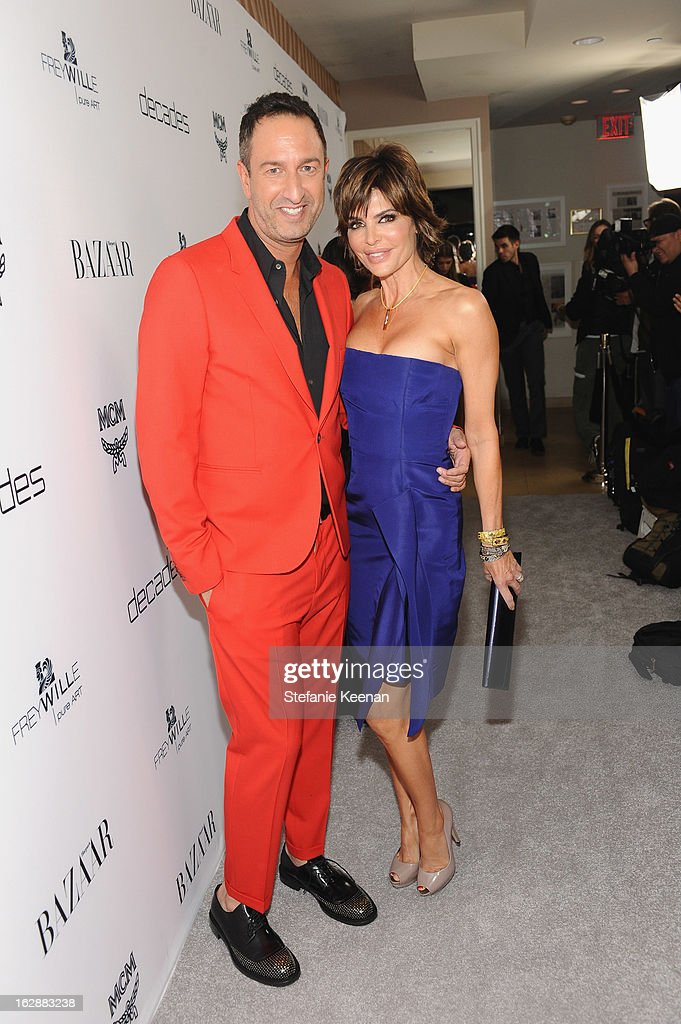 Decades co-owner Christos Garkinos and actress <a gi-track='captionPersonalityLinkClicked' href=/galleries/search?phrase=Lisa+Rinna&family=editorial&specificpeople=202100 ng-click='$event.stopPropagation()'>Lisa Rinna</a> attend the Harper's BAZAAR celebration of the launch of Bravo TV's 'The Dukes of Melrose' starring Cameron Silver and Christos Garkinos at Sunset Tower on February 28, 2013 in West Hollywood, California.