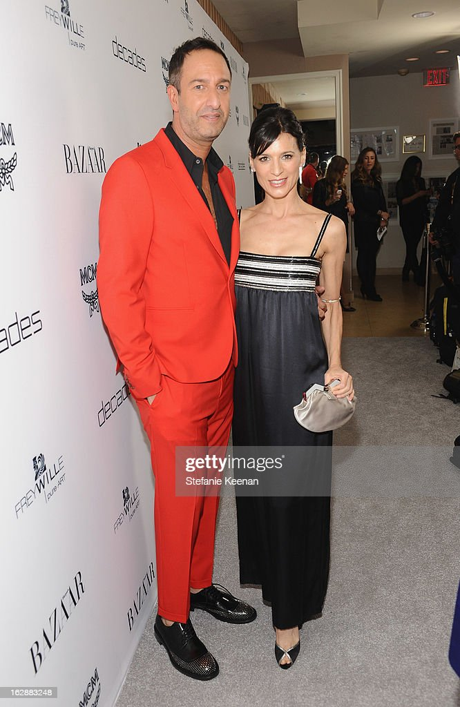 Decades co-owner Christos Garkinos and actress Perrey Reeves attend the Harper's BAZAAR celebration of the launch of Bravo TV's 'The Dukes of Melrose' starring Cameron Silver and Christos Garkinos at Sunset Tower on February 28, 2013 in West Hollywood, California.