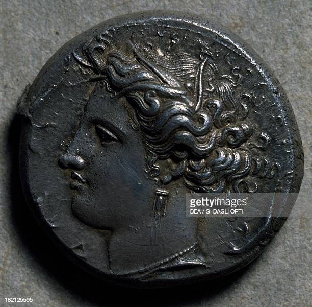 Decadrachm from Syracuse and signed Euinetos depicting Artemis Ancient Greek coins 5th century BC