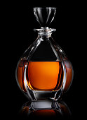 Decanter of cognac on a black background