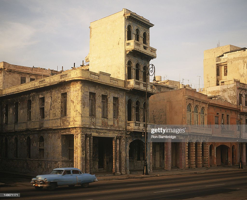 Decaying buildings on city street : Stock Photo