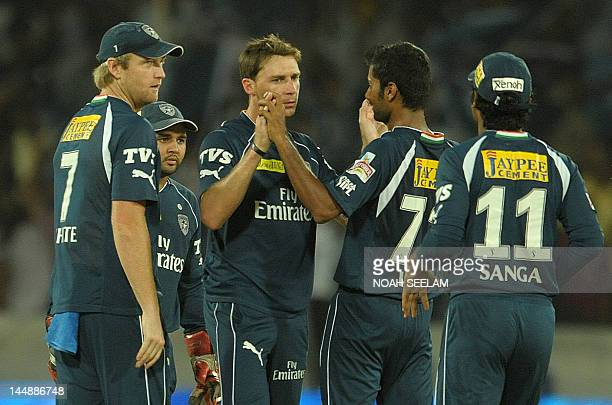 Deccan Chargers bowler Dale Steyn celebrates with teammates after taking the wicket of unseen Royal Challengers Bangalore batsman Zaheer Khan during...