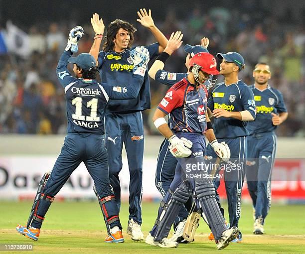 PACKAGE Deccan Chargers' bowler Ishant Sharma celebrates the wicket of Delhi Daredevils' batsmanNaman Ojha during the IPL Twenty 20 cricket match...