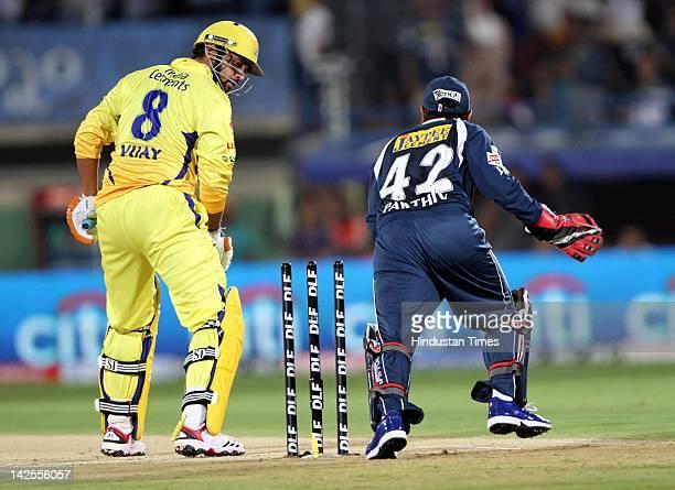 Deccan Chargers wicket keeper Parthiv Patel celebrates the wicket of Chennai Super Kings batsman Murli Vijay during DLF IPL Indian Premier league...