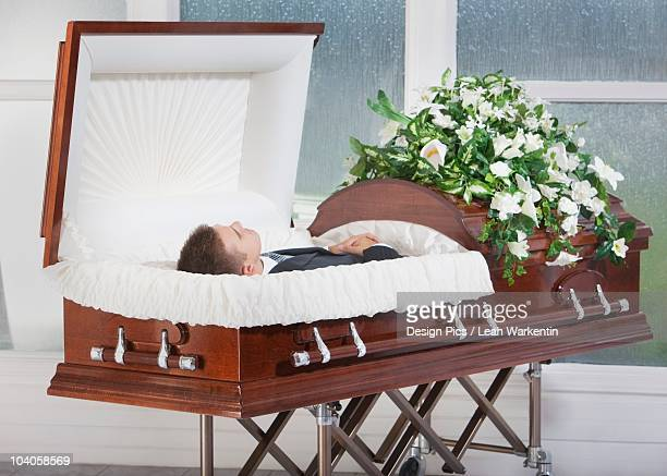 A Deceased Man Laying In A Coffin