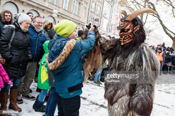 December 10th Munich About 300 masked beings frighten passers by during the big traditional run of the Krampusses around the Munich Christmas Market...