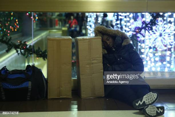 NEW YORK USA December 11 A traveler sleeps at New York Port Authority after it was reopened after an explosion in Manhattan borough of New York City...