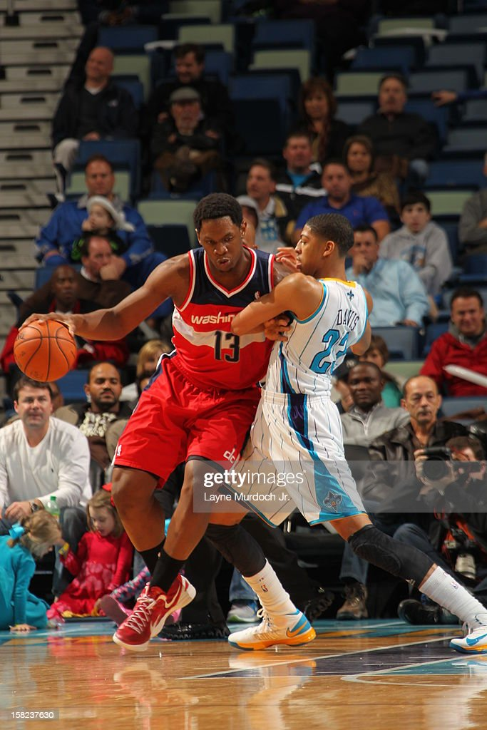 <a gi-track='captionPersonalityLinkClicked' href=/galleries/search?phrase=Kevin+Seraphin&family=editorial&specificpeople=6474998 ng-click='$event.stopPropagation()'>Kevin Seraphin</a> #13 of the Washington Wizards backs Anthony Davis #23 of the New Orleans Hornets on December 11, 2012 at the New Orleans Arena in New Orleans, Louisiana.