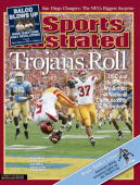 December 13 2004 Sports Illustrated Cover College Football USC Reggie Bush in action and victorious scoring 65 yard touchdown with forward flip into...