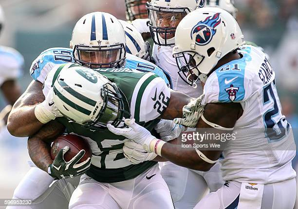 Tennessee Titans Safety Da'Norris Searcy [17026] pulls New York Jets Running Back Stevan Ridley [16898] down by his facemask resulting in a penalty...