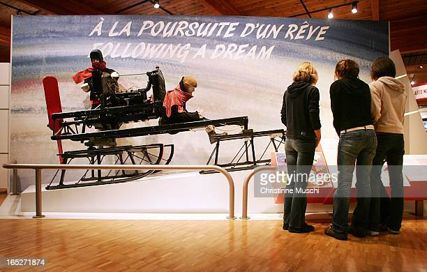 December 14 2004Three girls inspect an exhibition of the first vehicle built by Joseph Armand Bombardier in 1922 at the Bombardier museum in Valcourt...