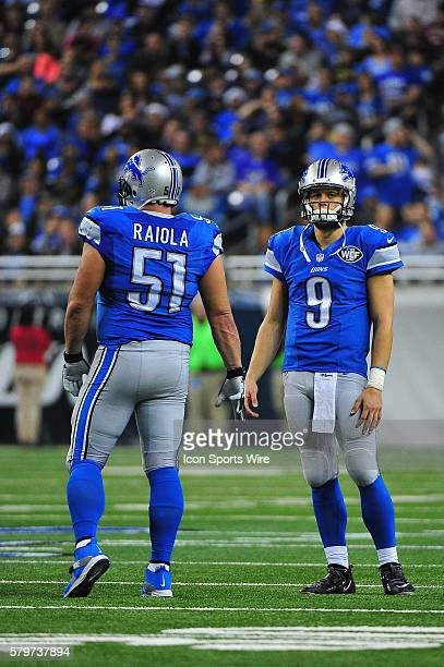 Detroit Lions quarterback Matthew Stafford talks with Detroit Lions center Dominic Raiola during a timeout during the game on Sunday afternoon Ford...