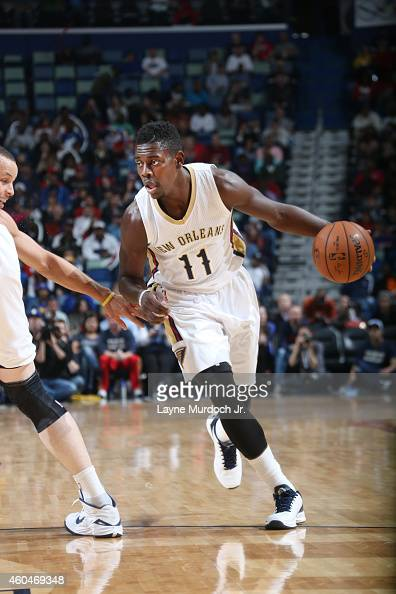 Jrue Holiday of the New Orleans Pelicans drives to the basket against the Golden State Warriors during the game on December 14 2014 at Smoothie King...
