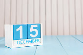 December 15th. Day 15 of month, calendar on wooden background. Winter concept. Empty space for text.