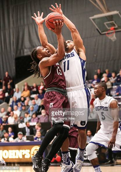 Arkansas Little Rock Trojans guard Marcus Johnson Jr shoots as Central Arkansas Bears guard Jeff Lowery tries to block his shot during an NCAA...