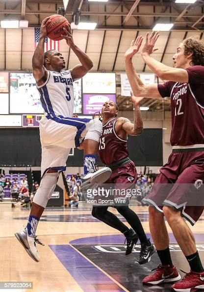 Central Arkansas Bears forward Justin Foreman drives to the basket as Arkansas Little Rock Trojans forward Lis Shoshi and Arkansas Little Rock...