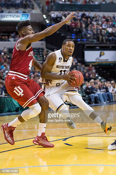 Notre Dame Fighting Irish guard Demetrius Jackson drives in the lane against Indiana Hoosiers guard Robert Johnson during the Crossroads Classic NCAA...