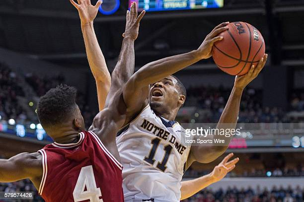 Notre Dame Fighting Irish guard Demetrius Jackson drives in against Indiana Hoosiers guard Robert Johnson during the Crossroads Classic NCAA...