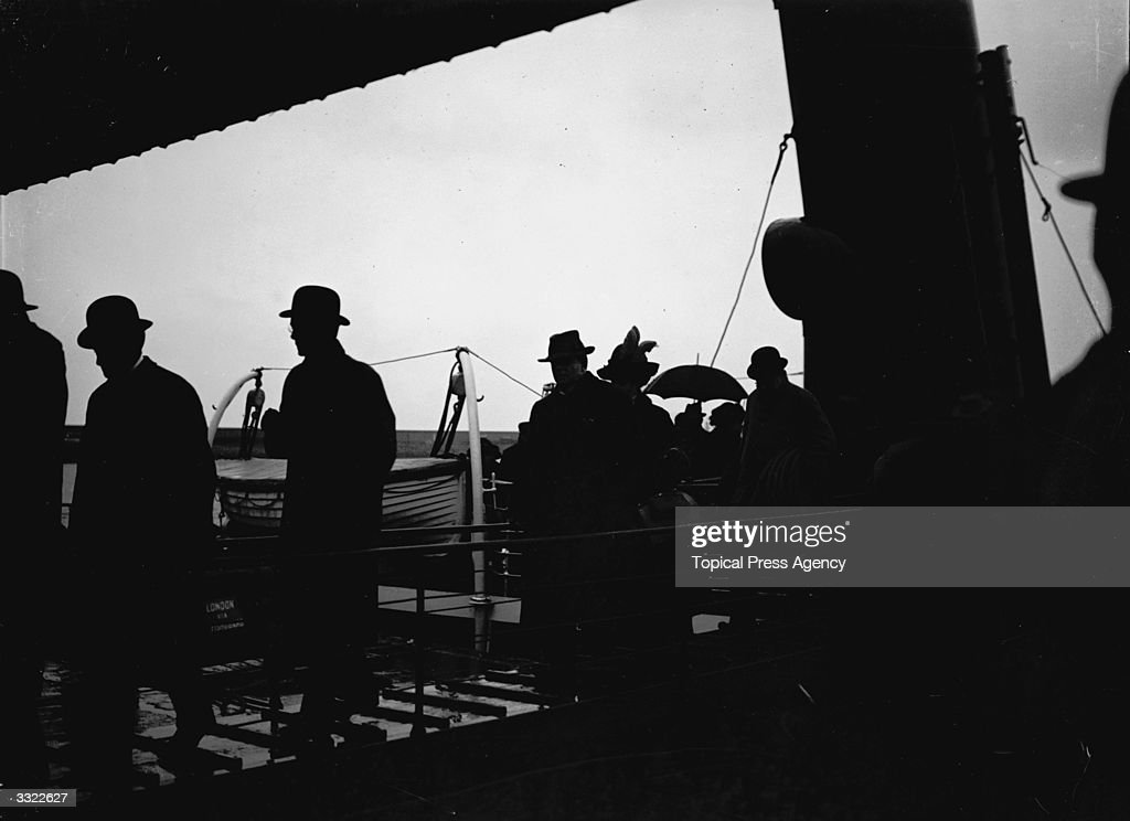 Passengers on British Cunard liner 'Lusitania's' gangway on arrival.
